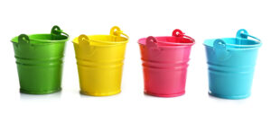 Four buckets of different colors, isolated on white, to illustrate delegation and capacity planning