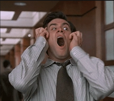 Screenshot of Jim Carey looking horrified, showing how accountants react to accounting errors.