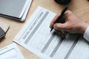 cropped view of man filling in Social Security Form Concept