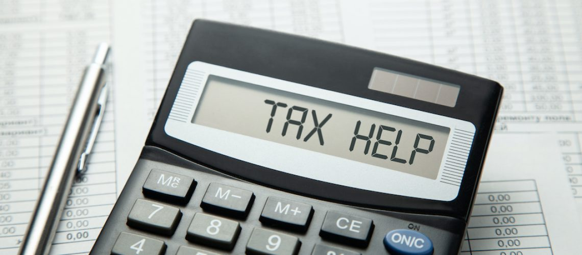 Tax help. On display of calculator is written tax help.