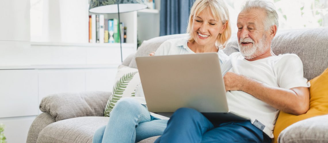 Couple senior using laptop