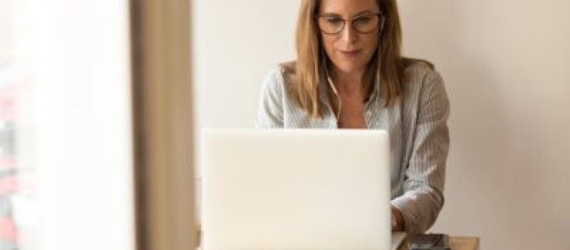 list of business owner using laptop to look for a list of tax deductions