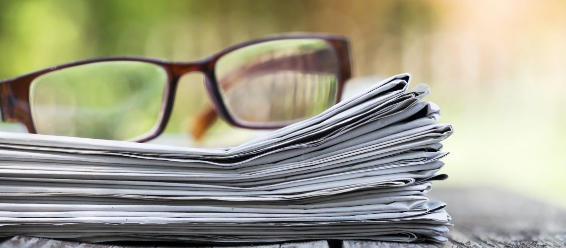 morning-news-concept-newspaper-and-glasses-P7P9BQ3